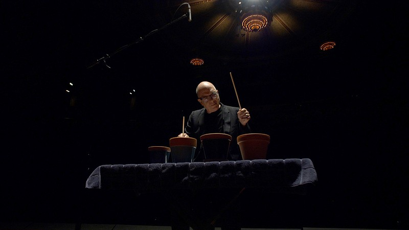 Percussionist and curator Steven Schick performs on flower pots for the