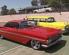Pictured, a red 1959 Chevy Impala and a yellow ...