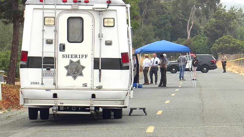 San Diego Sheriff's Department personnel at the scene of a fatal shooting in ...