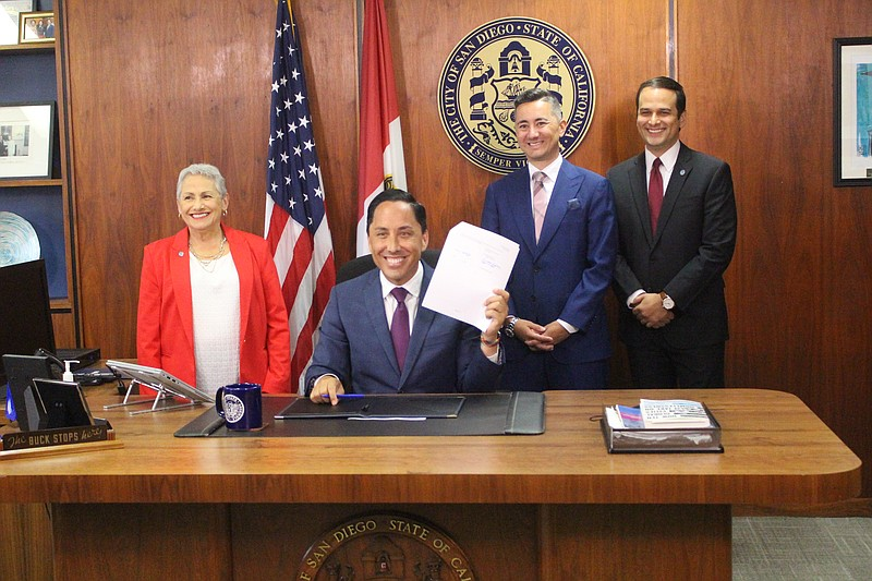 Todd Gloria signs the San Diego city budget in his office, San Diego, Calif. ...