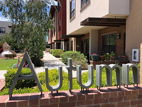 A sign at the Autumn Terrace Apartments in San Marcos own...