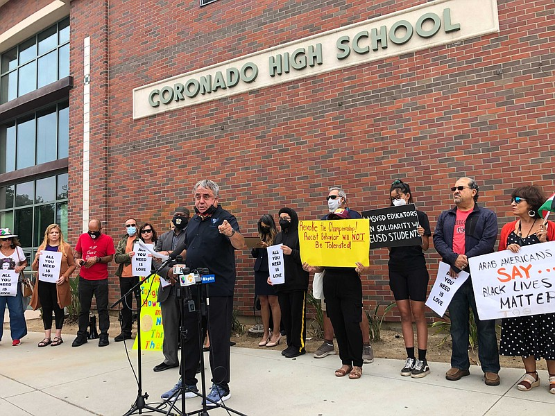 Local community groups hold a news briefing regarding an alleged racist incid...
