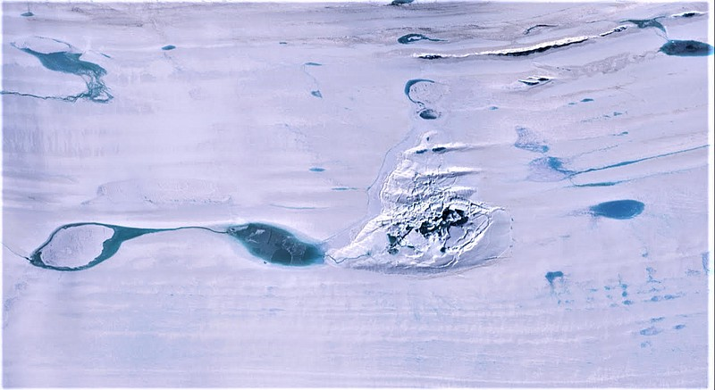 A huge lake of melted water collapses on the Amery ice shelf in the Antarctic...
