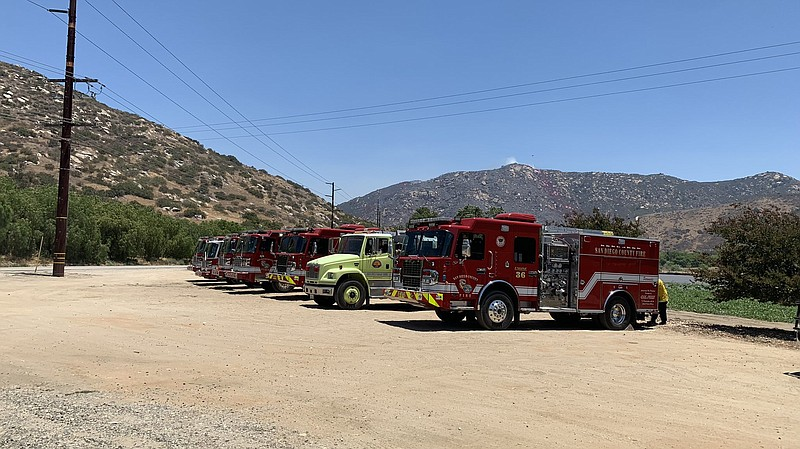 A row of fire engines at the Mesa Fire in Pala Mesa, June 24, 2021.