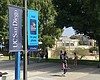Students and faculty walk on a pathway at the U...
