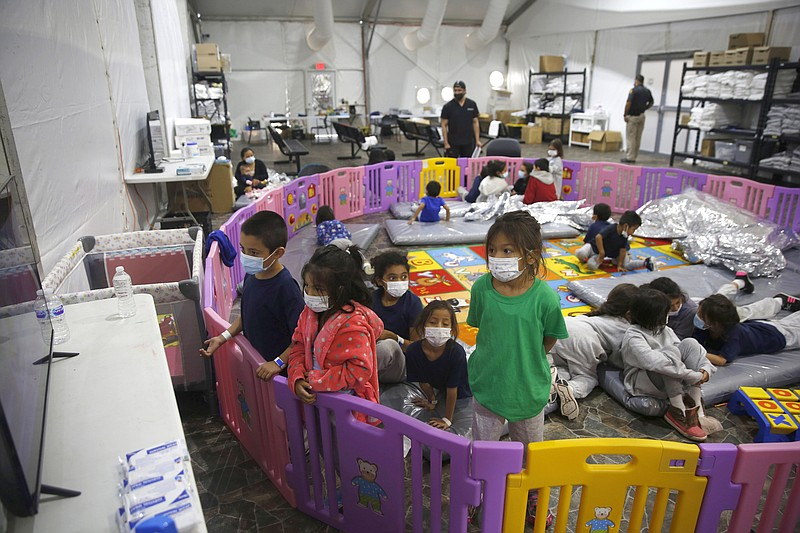 In this March 30, 2021 file photo Young unaccompanied migrants, from ages 3 t...