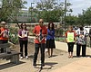 Community advocates are pictured outside of Las...