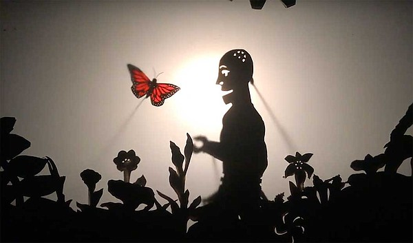 A still from the shadow puppetry production