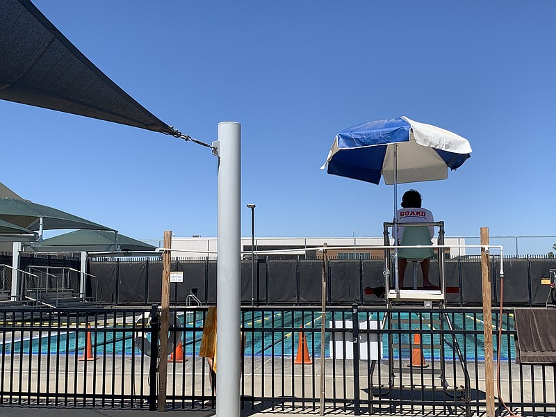 A lifeguard watches over the pool at the Memorial Rec Center, which will soon...