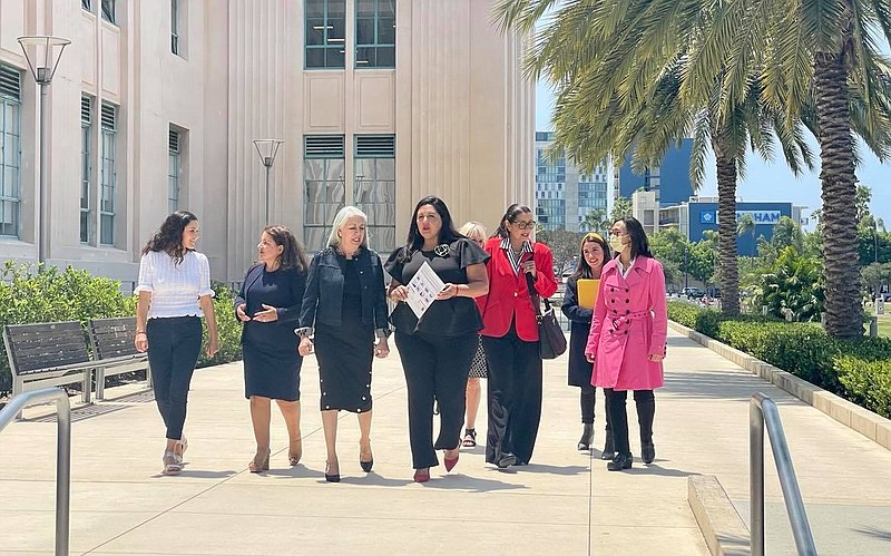 Mana De San Diego and Vice Chair Nora Vargas are pictured walking outside the...