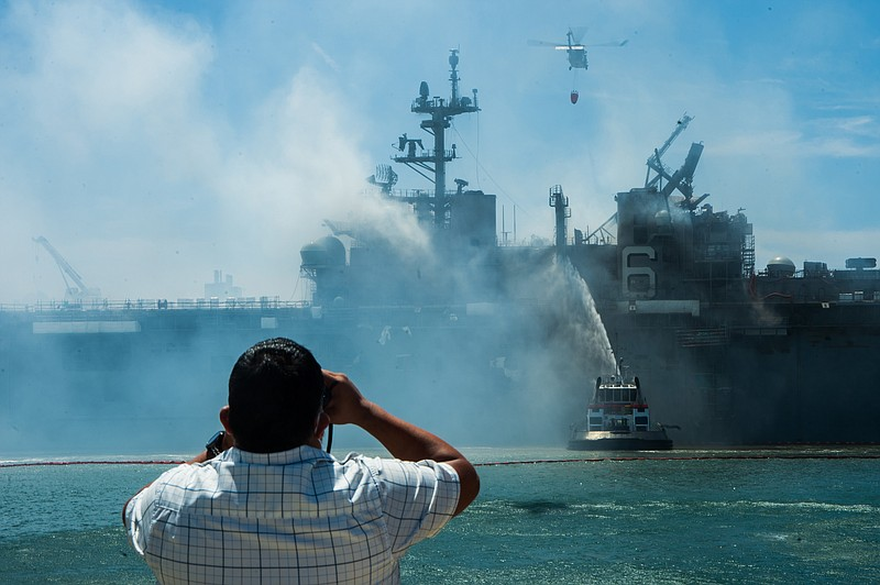 Fire still burns on the second day after fire on board the USS Bonhomme Richa...