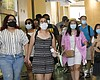 In this July 1, 2021, file photo visitors wear ...