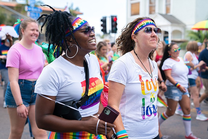 Marchers participate in the San Diego Pride Resilience March on July 11, 2021.
