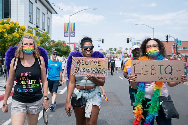 Participants marching in San Diego Pride's Resilience Mar...