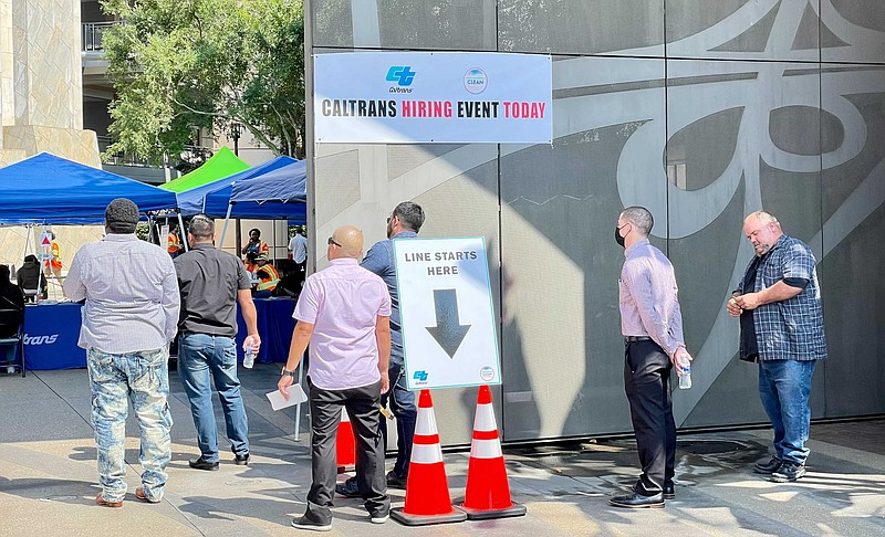 Job fair attendees are waiting in line at the Caltrans District 11 building i...