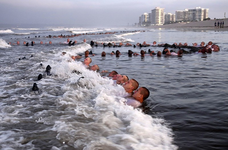 In this May 4, 2020 photo provided by the U.S. Navy, SEAL candidates particip...