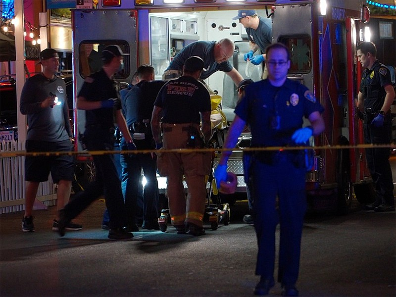 Paramedics taking care of a shooting victim in the Gaslamp Quarter, July 18, ...