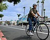 A cyclist rides down new protected bike lanes o...