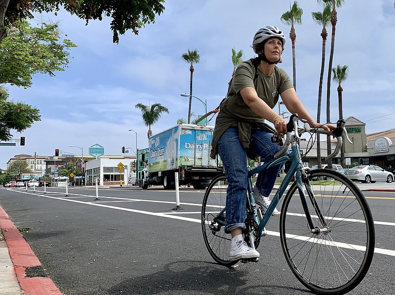 A cyclist rides down new protected bike lanes on 30th Street in North Park, J...