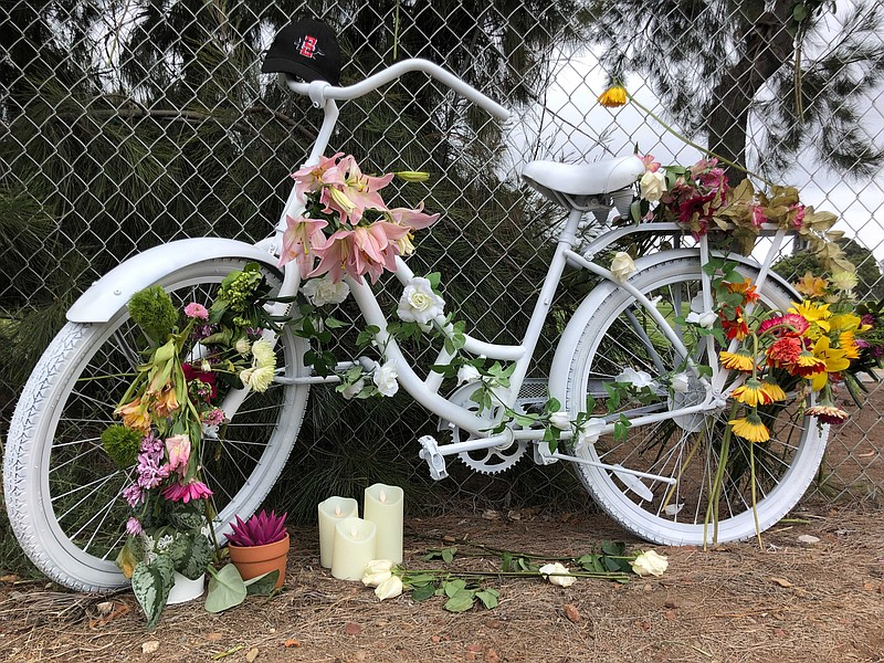 A memorial for Laura Shinn, who was struck and killed while biking to work, s...