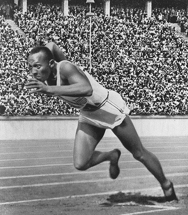 Jesse Owens at start of record-breaking 200-meter race, 1...