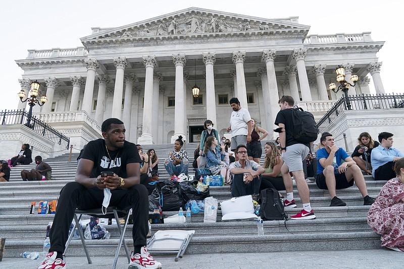 Supporters of Rep. Cori Bush, D-Mo., camp with her outside the U.S. Capitol, ...