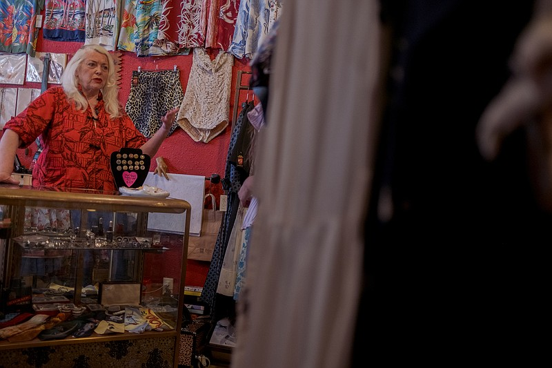 Gaile Higgins, is pictured at her vintage clothing store The Girl Can't Help ...