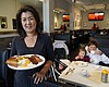 Jeannie Kim holds her popular bacon and eggs br...