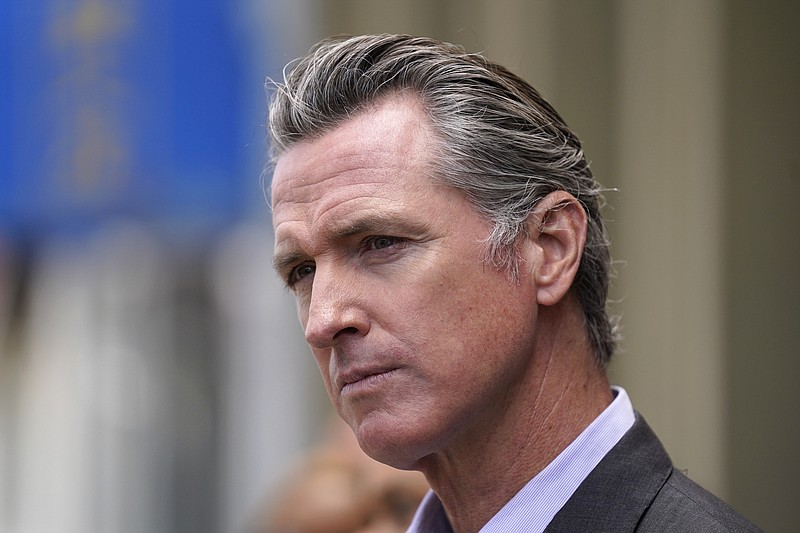 California Gov. Gavin Newsom listens to questions during a news conference in...