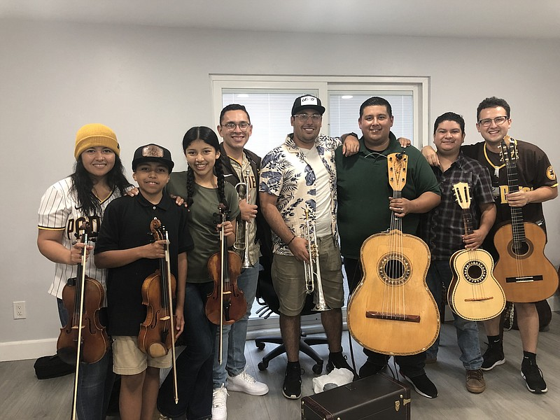 Mario Torres (third from the right) with the rest of the members of Mariachi ...