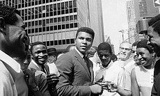 Muhammad Ali, is surrounded by autograph seeker...