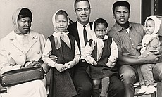 Malcolm X and family pose for a photo with Cass...