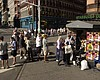 People line up to buy newspapers on Sept. 12, 2...