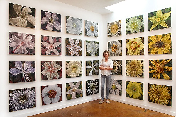 Artist Gail Roberts is pictured with a portion of her exh...