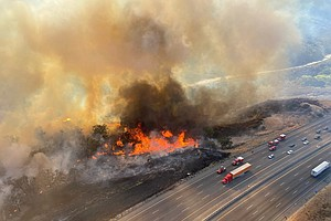 Photo for Firefighters Advance On Blaze That Shut California Highway