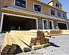 In this June 24, 2021 photo, lumber is piled at...