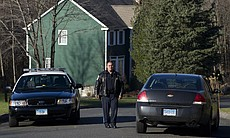 Police block a road near the house of Nancy Lanza in Newtown, Conn., on Saturday. Authorities say Lanza's son Adam killed her before opening fire at Sandy Hook Elementary School on Friday.