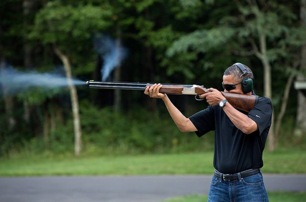 President Barack Obama shoots clay targets on the range at Camp David, Md., Saturday, Aug. 4, 2012.