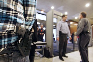 Unconcealed Guns Can Unsettle, But They're Often Legal