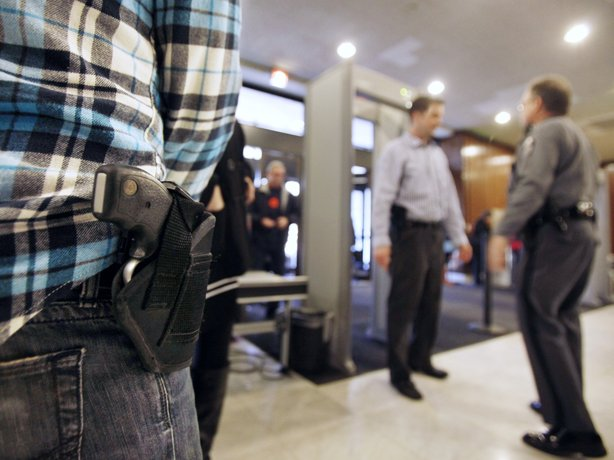 "A concealed handgun permit holder waits to enter the General Assembly building in Richmond, Va., on Monday, Jan. 21. Known as ""gun lobby day,"" crowds of gun owners visited the capital to argue in favor of gun rights. Most states in the U.S. allow people to openly carry guns in certain public places."