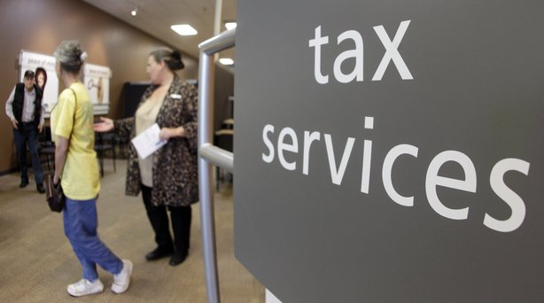 Customers line up at an H&R Block office in Nashville, Tenn., on April 17, the deadline for filing 2011 federal income taxes.
