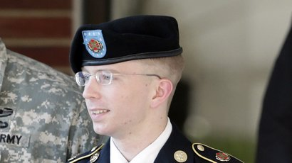 Army Pfc. Bradley Manning is escorted out of a courthouse in Fort Meade, Md.,...