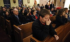 Mourners gather for a vigil service for victims of the Sandy Hook Elementary School shooting, at the St. Rose of Lima Roman Catholic Church in Newtown, Conn. on Friday night.