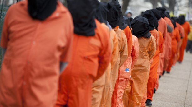 Demonstrators, dressed as detainees, march on Jan. 11 against the U.S. military detention facility in Guantanamo Bay, Cuba, and call for President Obama to close the facility.