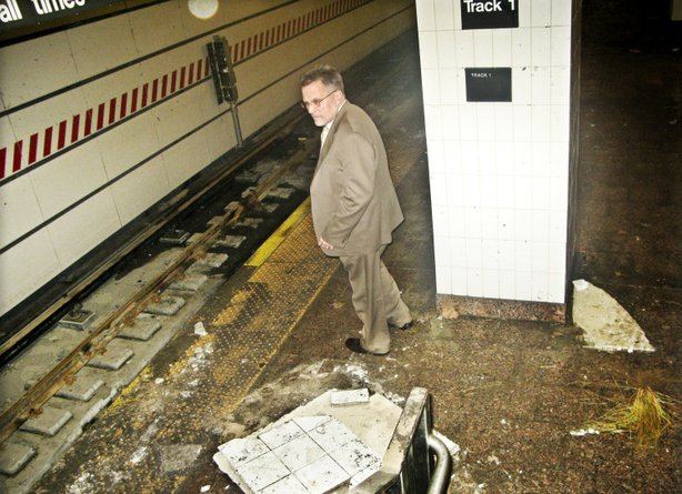 Joseph Leader, chief maintenance officer of the New York subway system, surveys damage from Superstorm Sandy in the South Ferry station.