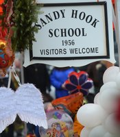 Angel wings and balloons at a makeshift shrine outside Sandy Hook Elementary.