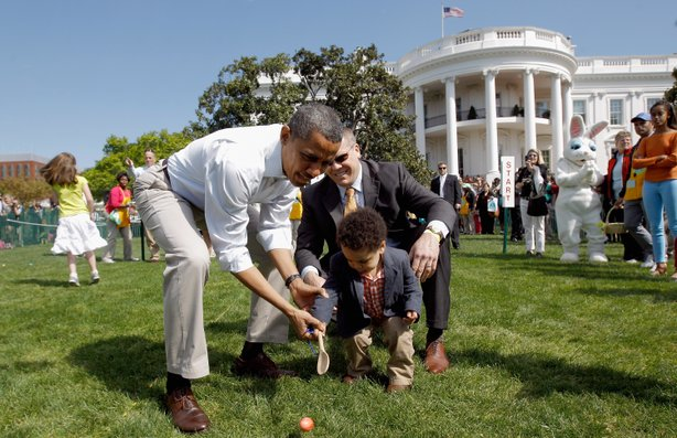 President Obama helps a young participant roll an egg during the 2012 White House Easter Egg Roll on the South Lawn. This year's event will take place Monday.