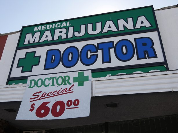 Signage outside a Los Angeles medical marijuana evaluation clinic last year.