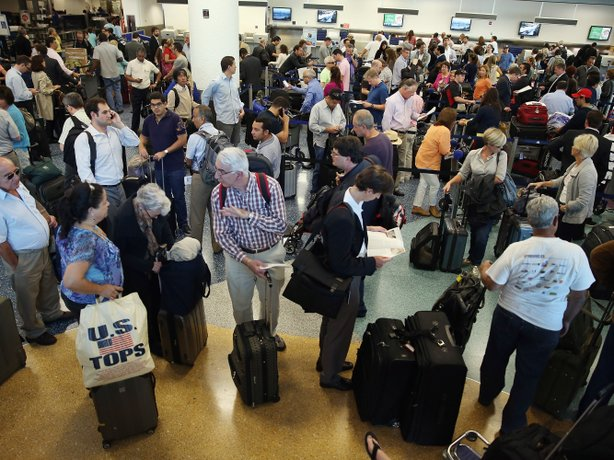 American Airlines passengers wait in line for a flight at Miami International...