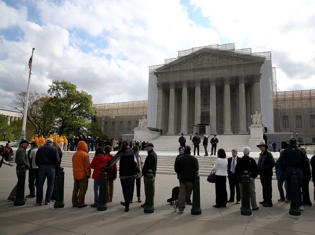 People line up to enter the Supreme Court building on April 22, when the court heard arguments in the